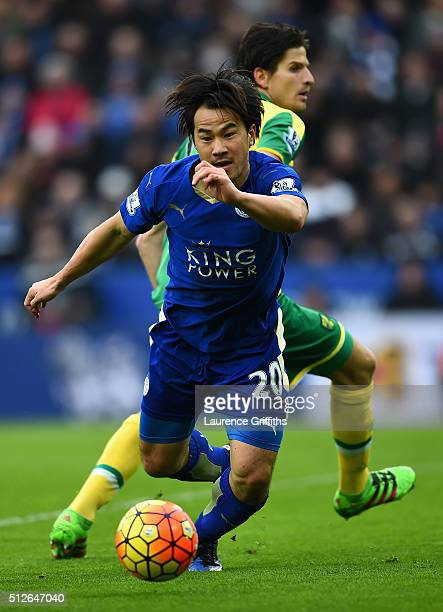 Shinji Okazaki of Leicester City turns Timm Klose of Norwich City during the Barclays Premier League match between Leicester City and Norwich City at...