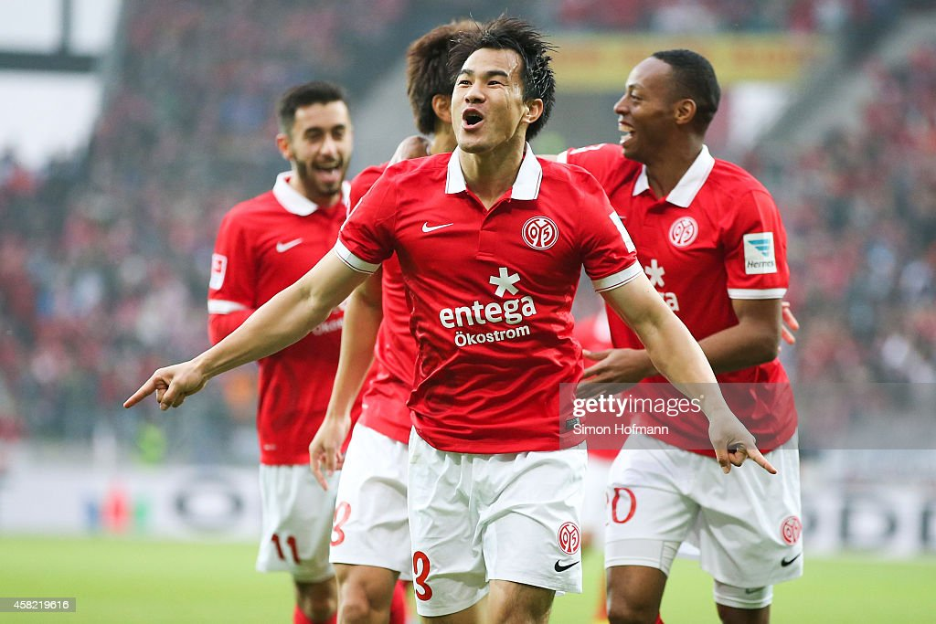 <a gi-track='captionPersonalityLinkClicked' href=/galleries/search?phrase=Shinji+Okazaki&family=editorial&specificpeople=4320771 ng-click='$event.stopPropagation()'>Shinji Okazaki</a> of Mainz celebrates his team's first goal during the Bundesliga match between 1. FSV Mainz 05 and SV Werder Bremen at Coface Arena on November 1, 2014 in Mainz, Germany.