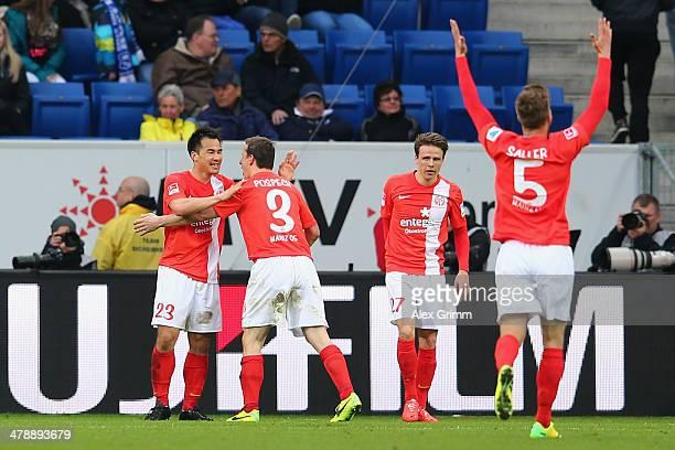 Shinji Okazaki of Mainz celebrates his team's fourth goal with team mates Zdenek Pospech Nicolai Mueller and Benedikt Saller during the Bundesliga...