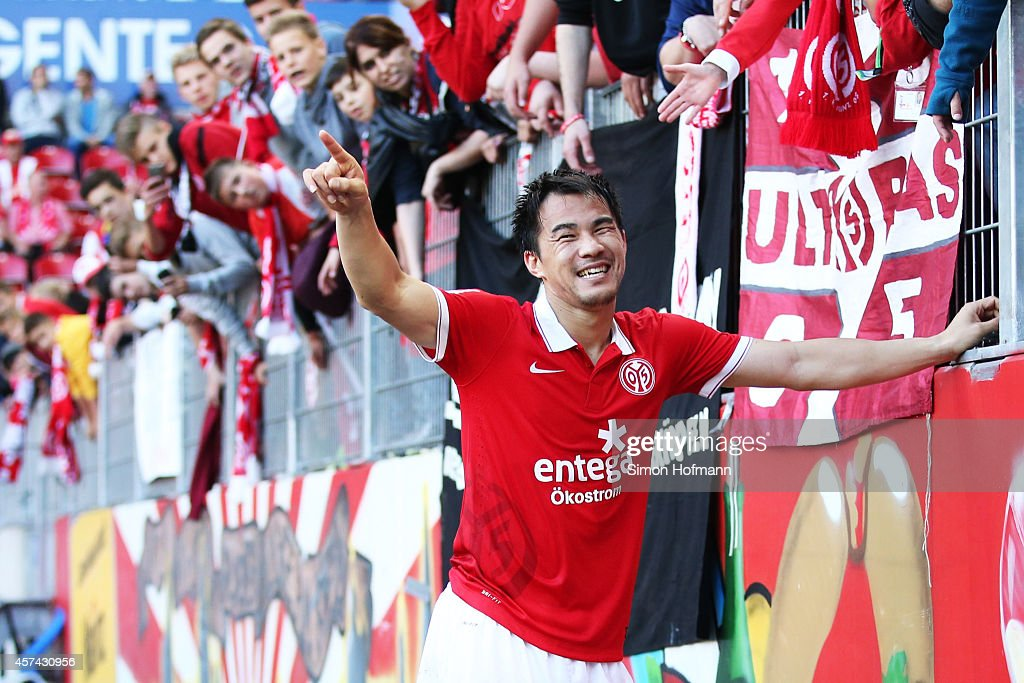 <a gi-track='captionPersonalityLinkClicked' href=/galleries/search?phrase=Shinji+Okazaki&family=editorial&specificpeople=4320771 ng-click='$event.stopPropagation()'>Shinji Okazaki</a> of Mainz celebrates winning after the Bundesliga match between 1. FSV Mainz 05 and FC Augsburg at Coface Arena on October 18, 2014 in Mainz, Germany.