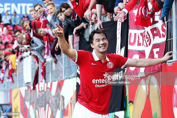 Shinji Okazaki of Mainz celebrates winning after the Bundesliga match between 1 FSV Mainz 05 and FC Augsburg at Coface Arena on October 18 2014 in...