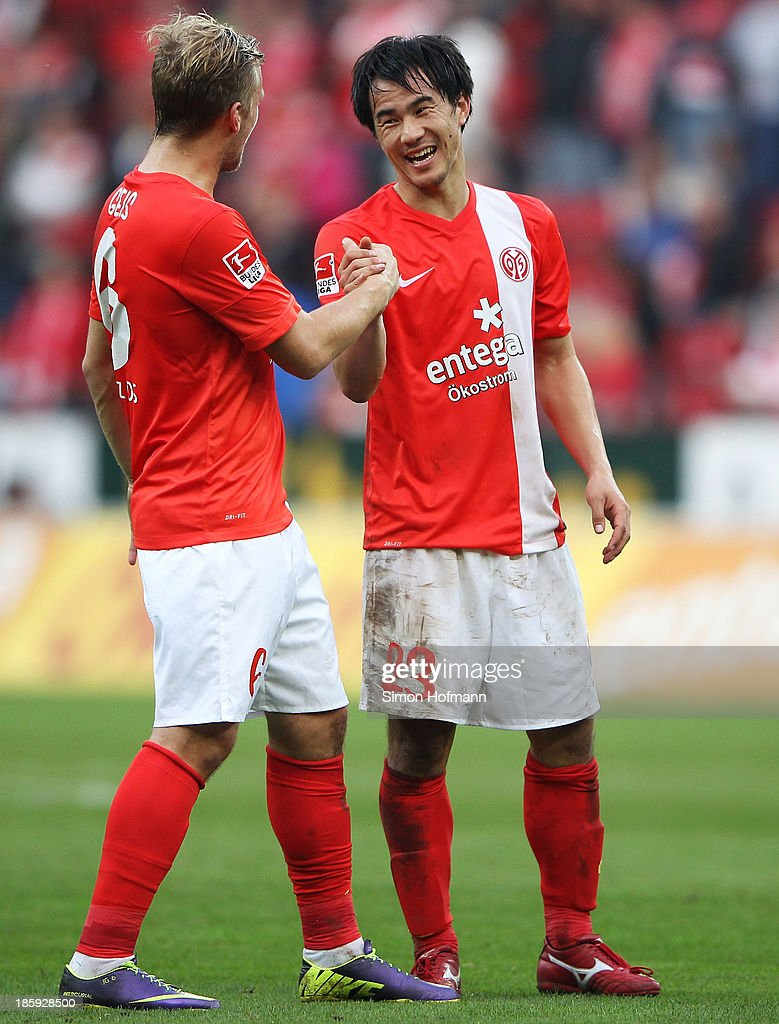 <a gi-track='captionPersonalityLinkClicked' href=/galleries/search?phrase=Shinji+Okazaki&family=editorial&specificpeople=4320771 ng-click='$event.stopPropagation()'>Shinji Okazaki</a> of Mainz (R) celebrates winning with team mate Johannes Geis of Mainz after the Bundesliga match between 1. FSV Mainz and Eintracht Braunschweig at Coface Arena on October 26, 2013 in Mainz, Germany.