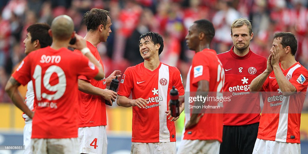 <a gi-track='captionPersonalityLinkClicked' href=/galleries/search?phrase=Shinji+Okazaki&family=editorial&specificpeople=4320771 ng-click='$event.stopPropagation()'>Shinji Okazaki</a> of Mainz (C) celebrates winning with team mates after the Bundesliga match between 1. FSV Mainz and Eintracht Braunschweig at Coface Arena on October 26, 2013 in Mainz, Germany.