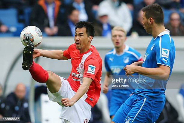 Shinji Okazaki of Mainz is challenged by Niklas Suele of Hoffenheim during the Bundesliga match between 1899 Hoffenheim and 1 FSV Mainz 05 at Wirsol...