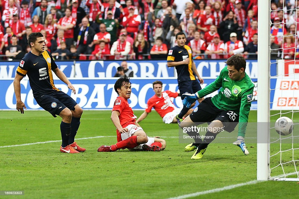 <a gi-track='captionPersonalityLinkClicked' href=/galleries/search?phrase=Shinji+Okazaki&family=editorial&specificpeople=4320771 ng-click='$event.stopPropagation()'>Shinji Okazaki</a> (C) of Mainz scores his team's second goal against goalkeeper Faniel Davari of Braunschweig during the Bundesliga match between 1. FSV Mainz and Eintracht Braunschweig at Coface Arena on October 26, 2013 in Mainz, Germany.