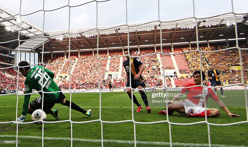 <a gi-track='captionPersonalityLinkClicked' href=/galleries/search?phrase=Shinji+Okazaki&family=editorial&specificpeople=4320771 ng-click='$event.stopPropagation()'>Shinji Okazaki</a> of Mainz scores his team's second goal past goalkeeper Faniel Davari of Braunschweig during the Bundesliga match between 1. FSV Mainz and Eintracht Braunschweig at Coface Arena on October 26, 2013 in Mainz, Germany.