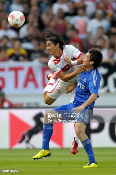 Shinji Okazaki of Stuttgart and Artur Yusupov of Moscow battle for the ball during the UEFA Europa League Qualifying PlayOff match between VfB...