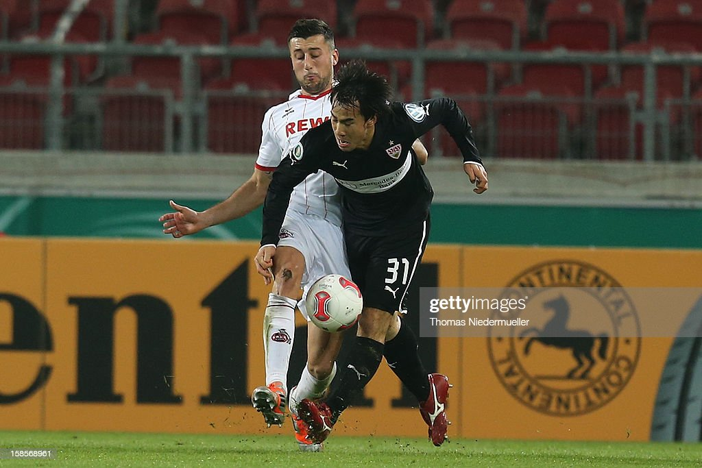 <a gi-track='captionPersonalityLinkClicked' href=/galleries/search?phrase=Shinji+Okazaki&family=editorial&specificpeople=4320771 ng-click='$event.stopPropagation()'>Shinji Okazaki</a> (R)of Stuttgart battles for the ball with <a gi-track='captionPersonalityLinkClicked' href=/galleries/search?phrase=Dominic+Maroh&family=editorial&specificpeople=5633010 ng-click='$event.stopPropagation()'>Dominic Maroh</a> (L) of Koeln during the DFB cup round of sixteen match between VfB Stuttgart and 1.FC Koeln at Mercedes-Benz Arena on December 19, 2012 in Stuttgart, Germany.
