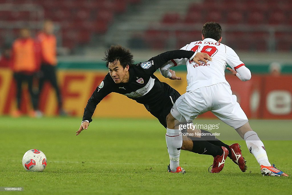 <a gi-track='captionPersonalityLinkClicked' href=/galleries/search?phrase=Shinji+Okazaki&family=editorial&specificpeople=4320771 ng-click='$event.stopPropagation()'>Shinji Okazaki</a> (L) of Stuttgart battles for the ball with Mato Jajalo (R) of Koeln during the DFB cup round of sixteen match between VfB Stuttgart and 1.FC Koeln at Mercedes-Benz Arena on December 19, 2012 in Stuttgart, Germany.