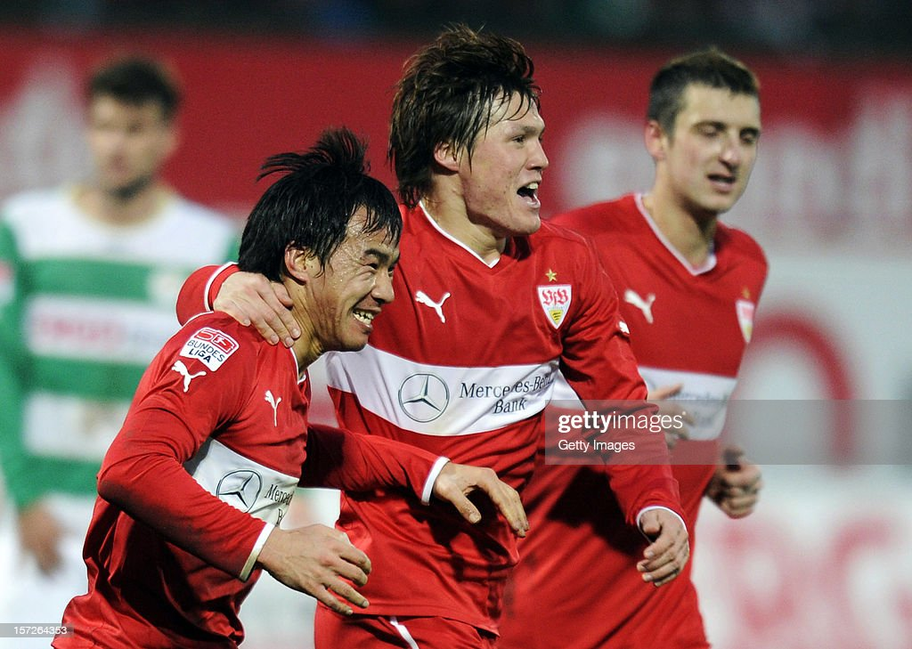 <a gi-track='captionPersonalityLinkClicked' href=/galleries/search?phrase=Shinji+Okazaki&family=editorial&specificpeople=4320771 ng-click='$event.stopPropagation()'>Shinji Okazaki</a> of Stuttgart celebrates his team's first goal with team mates <a gi-track='captionPersonalityLinkClicked' href=/galleries/search?phrase=Gotoku+Sakai&family=editorial&specificpeople=7015160 ng-click='$event.stopPropagation()'>Gotoku Sakai</a> and <a gi-track='captionPersonalityLinkClicked' href=/galleries/search?phrase=Zdravko+Kuzmanovic&family=editorial&specificpeople=3966109 ng-click='$event.stopPropagation()'>Zdravko Kuzmanovic</a> during the Bundesliga match between SpVgg Greuther Fuerth and VfB Stuttgart at Trolli-Arena on December 1, 2012 in Fuerth, Germany.