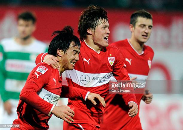 Shinji Okazaki of Stuttgart celebrates his team's first goal with team mates Gotoku Sakai and Zdravko Kuzmanovic during the Bundesliga match between...