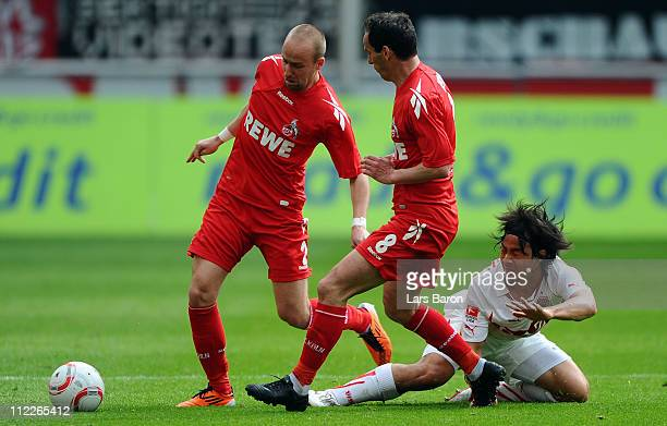 Shinji Okazaki of Stuttgart challenges Miso Brecko and Petit of Koeln during the Bundesliga match between 1 FC Koeln and VfB Suttgart at...
