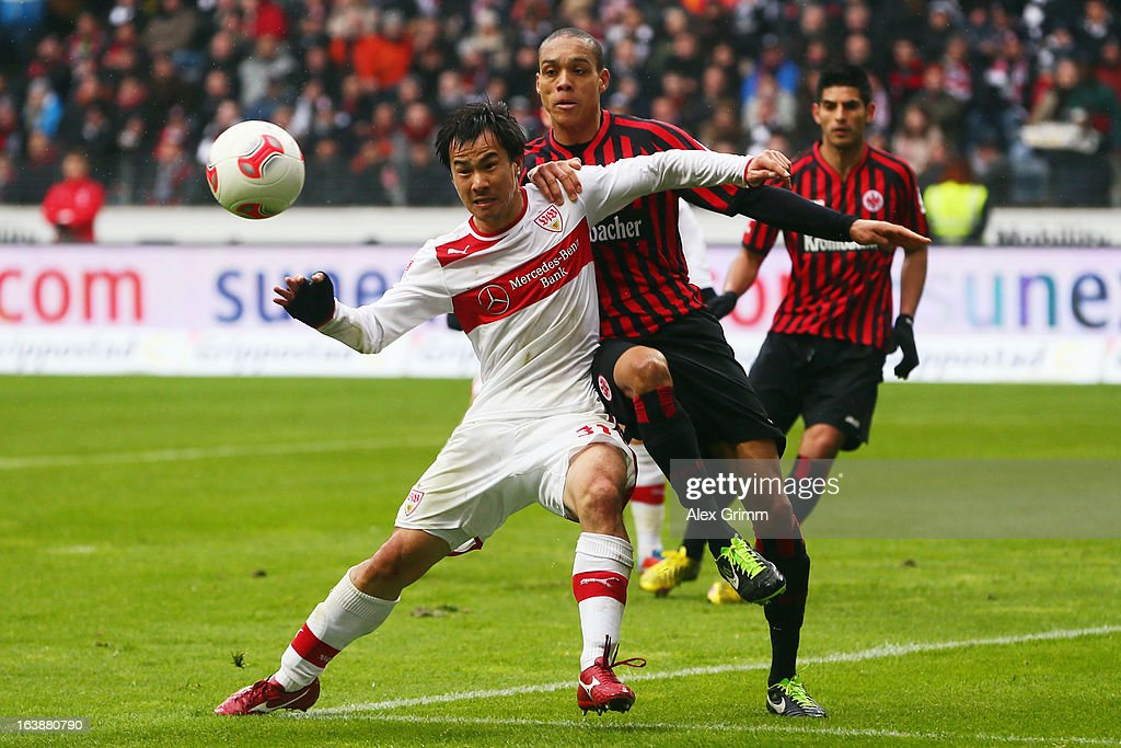 <a gi-track='captionPersonalityLinkClicked' href=/galleries/search?phrase=Shinji+Okazaki&family=editorial&specificpeople=4320771 ng-click='$event.stopPropagation()'>Shinji Okazaki</a> (L) of Stuttgart is challenged by Bamba Anderson of Frankfurt during the Bundesliga match between Eintracht Frankfurt and VfB Stuttgart at Commerzbank-Arena on March 17, 2013 in Frankfurt am Main, Germany.