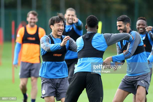 Shinji Okazaki Riyad Mahrez and Islam Slimani share a joke with Kelechi Iheanacho during the Leicester City training session at Belvoir Drive...
