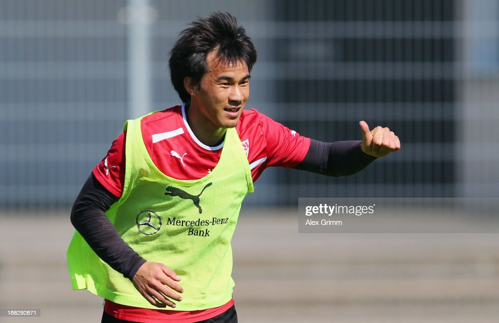 Shinji Okazaki shows thumbs up during a VfB Stuttgart training session at the club's premises on May 8, 2013 in Stuttgart, Germany.