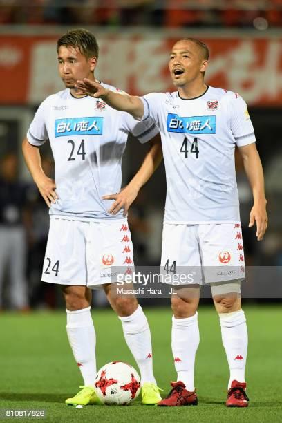 Shinji Ono and Akito Fukumori of Consadole Sapporo prepare for a free kick during the JLeague J1 match between Omiya Ardija and Consadole Sapporo at...
