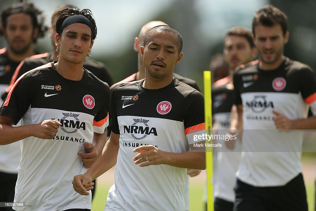 Shinji Ono and teammates warm up during a Western Sydney Wanderers A-League training session at Blacktown International Sportspark on February 19, 2013 in Sydney, Australia.