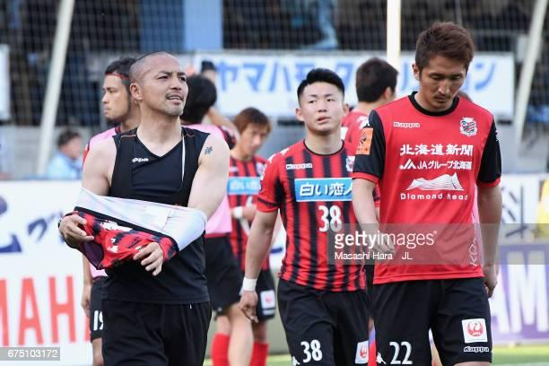 Shinji Ono Daiki Suga and Hidetaka Kanazono of Consadole Sapporo react after their 22 draw in the JLeague J1 match between Jubilo Iwata and Consadole...