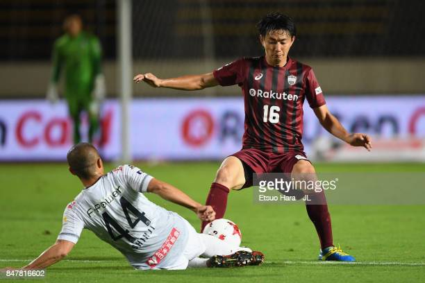 Shinji Ono of Consadole Sapporo and Hideto Takahashi of Vissel Kobe compete for the ball during the JLeague J1 match between Vissel Kobe and...