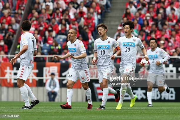 Shinji Ono of Consadole Sapporo encourages his team mates after his side's second goal during the JLeague J1 match between Urawa Red Diamonds and...