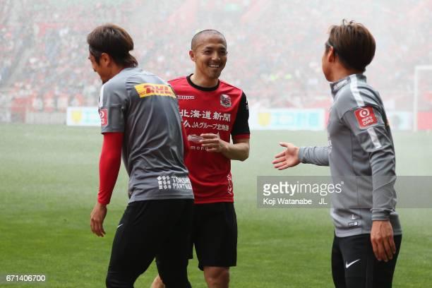 Shinji Ono of Consadole Sapporo greets Daisuke Nasu and Kazuki Nagasawa of Urawa Red Diamonds prior to the JLeague J1 match between Urawa Red...