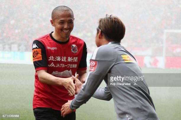 Shinji Ono of Consadole Sapporo greets Kazuki Nagasawa of Urawa Red Diamonds prior to the JLeague J1 match between Urawa Red Diamonds and Consadole...