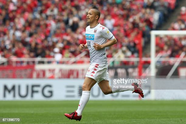 Shinji Ono of Consadole Sapporo runs into the pitch after broudght in during the JLeague J1 match between Urawa Red Diamonds and Consadole Sapporo at...