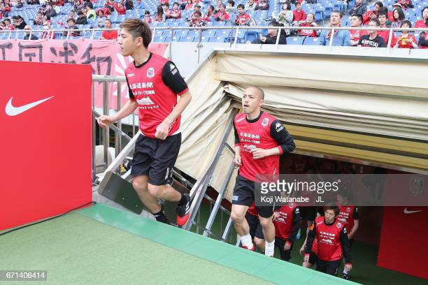 Shinji Ono of Consadole Sapporo runs into the pitch for warming up prior to the JLeague J1 match between Urawa Red Diamonds and Consadole Sapporo at...