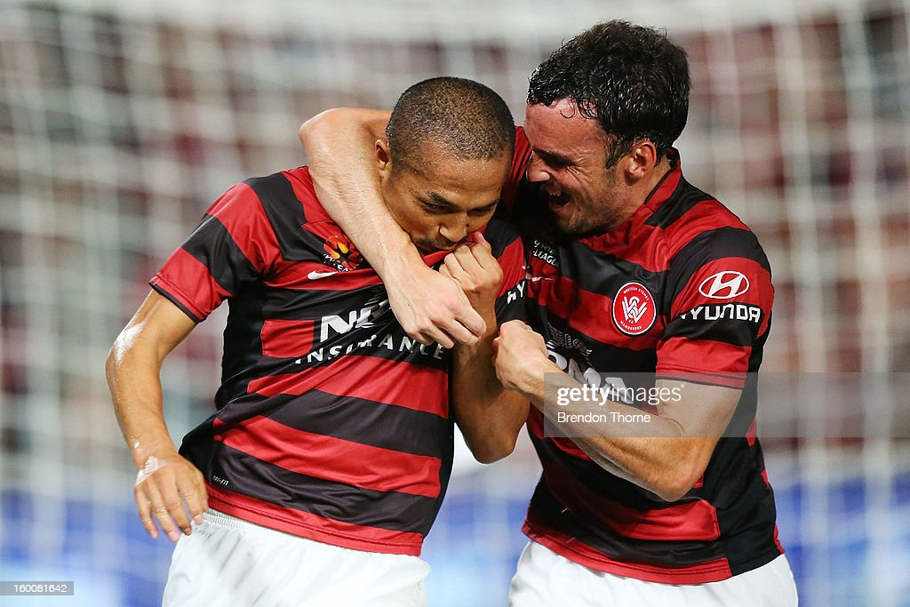 <a gi-track='captionPersonalityLinkClicked' href=/galleries/search?phrase=Shinji+Ono&family=editorial&specificpeople=550970 ng-click='$event.stopPropagation()'>Shinji Ono</a> of the Wanderers celebrates with team mate <a gi-track='captionPersonalityLinkClicked' href=/galleries/search?phrase=Mark+Bridge&family=editorial&specificpeople=1630520 ng-click='$event.stopPropagation()'>Mark Bridge</a> after scoring a penalty during the round 18 A-League match between the Western Sydney Wanderers and the Melbourne Heart at Parramatta Stadium on January 26, 2013 in Sydney, Australia.