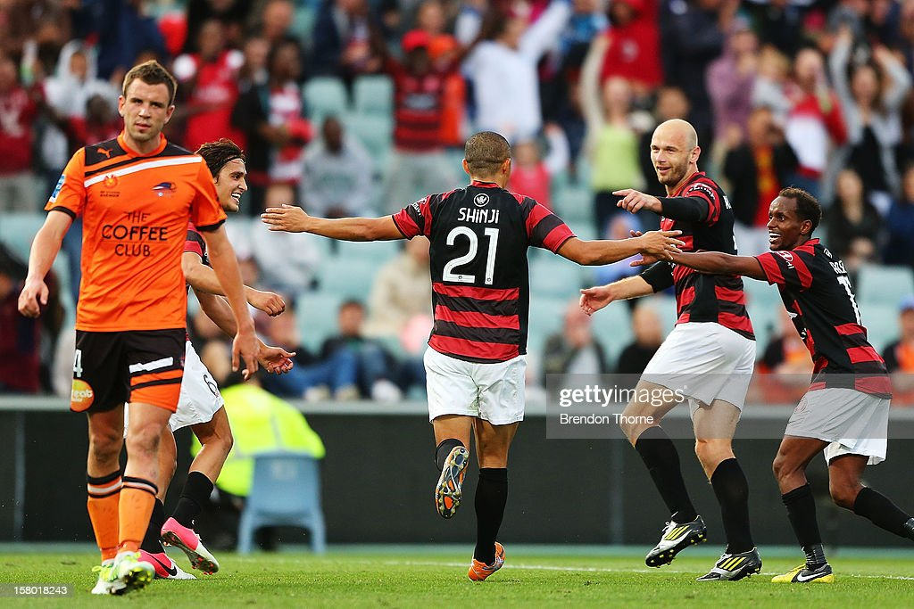 <a gi-track='captionPersonalityLinkClicked' href=/galleries/search?phrase=Shinji+Ono&family=editorial&specificpeople=550970 ng-click='$event.stopPropagation()'>Shinji Ono</a> of the Wanderers celebrates with team mates after scoring a penalty goal during the round ten A-League match between the Western Sydney Wanderers and the Brisbane Roar at Parramatta Stadium on December 9, 2012 in Sydney, Australia.