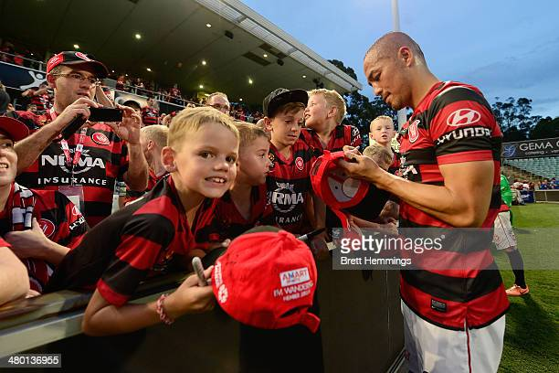 Shinji Ono of the Wanderers signs autographs for young fans during the round 24 ALeague match between the Western Sydney Wanderers and Perth Glory at...