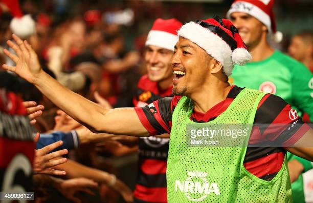 Shinji Ono of the Wanderes celebrates with fans after winning the round 11 ALeague match between the Western Sydney Wanderers and the Central Coast...