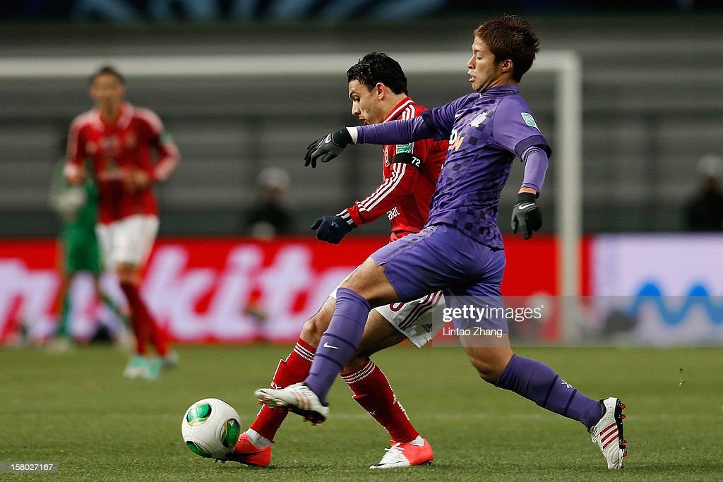 Shinji Tsujio (R) of Sanfrecce Hiroshima challenges with Gedo (L) of Al-Ahly SC during the FIFA Club World Cup Quarter Final match between Sanfrecce Hiroshima and Al-Ahly SC at Toyota Stadium on December 9, 2012 in Toyota, Japan.