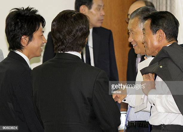 Shinjiro Koizumi greets ex Prime Minister Yoshiro Mori and Prime Minister Taro Aso after the Joint Plenary Meeting of Party Members of Both Houses of...