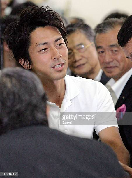 Shinjiro Koizumi shakes hands with his supporters after winning the Kanagawa No11 single seat constituency during the lower house election at the his...