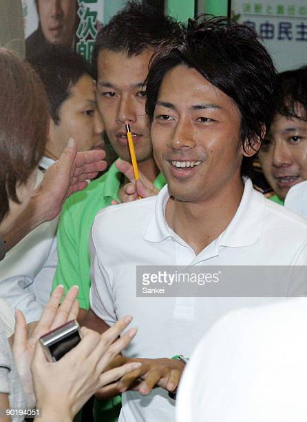 Shinjiro Koizumi smiles as he wins the Kanagawa No11 single seat constituency during the lower house election at the his election campaign...