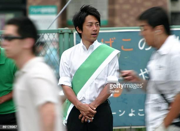 Shinjiro Koizumi son of former Prime Minister Junichiro Koizumi stands to introduce himself to commuters at East Japan Railways Co Yokosuka Station...