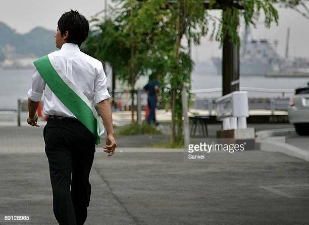 Shinjiro Koizumi son of former Prime Minister Junichiro Koizumi walks at East Japan Railways Co Yokosuka Station on July 17 2009 in Yokosuka Kanagawa...