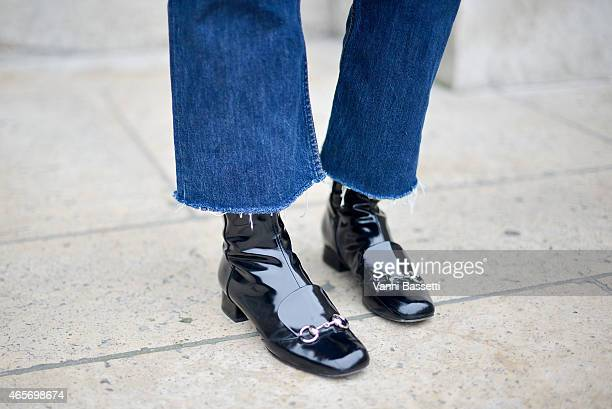 Shink Kim poses wearing Gucci shoes on Day 7 of Paris Fashion Week Womenswear FW15 on March 9 2015 in Paris France