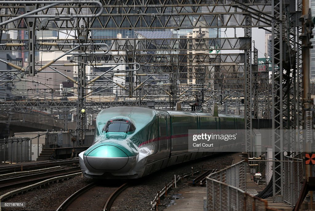 A Shinkansen bullet train arrives at Tokyo Train Station on May 02, 2016 in Tokyo, Japan. The Shinkansen is a network of high-speed railway lines in Japan currently consisting of 2,764.6 km (1,717.8 mi) of lines with maximum speeds of 240-320 km/h (150-200 mph). The network presently links most major cities on the islands of Honshu and Kyushu, and Hakodate on northern island of Hokkaido. The maximum operating speed is 320 km/h (200 mph) though test runs have reached up to a world record 603 km/h (375 mph) for maglev trains in April 2015.
