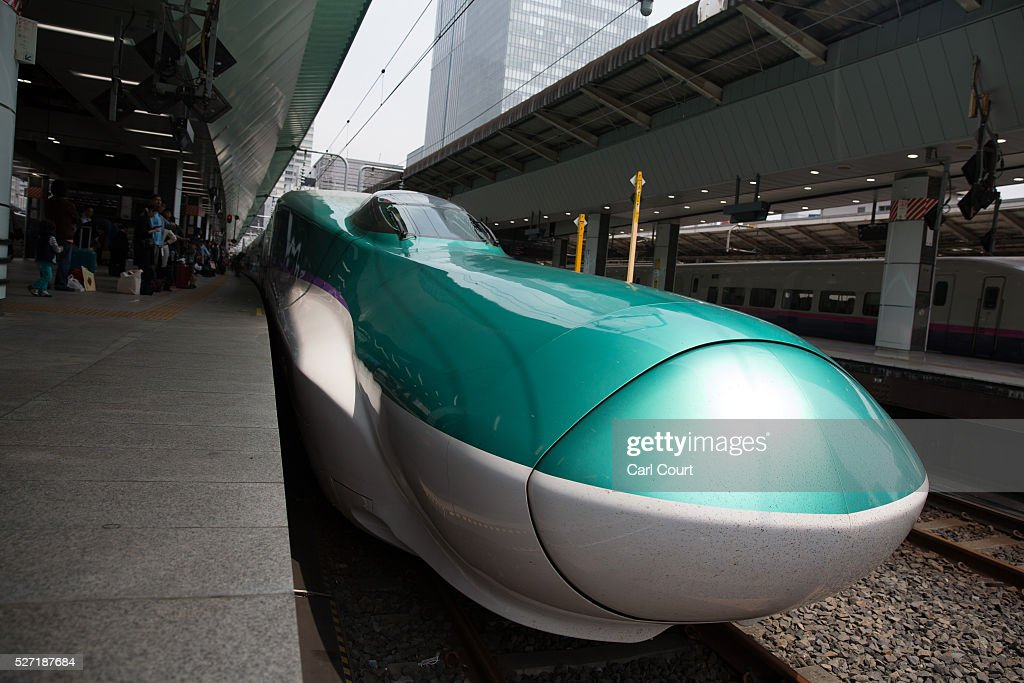 A Shinkansen bullet train waits at Tokyo Train Station on May 02, 2016 in Tokyo, Japan. The Shinkansen is a network of high-speed railway lines in Japan currently consisting of 2,764.6 km (1,717.8 mi) of lines with maximum speeds of 240-320 km/h (150-200 mph). The network presently links most major cities on the islands of Honshu and Kyushu, and Hakodate on northern island of Hokkaido. The maximum operating speed is 320 km/h (200 mph) though test runs have reached up to a world record 603 km/h (375 mph) for maglev trains in April 2015.