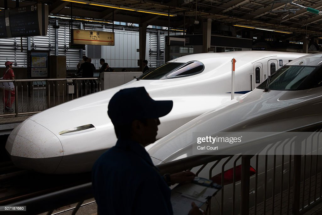 Shinkansen bullet trains are stopped at Tokyo Train Station on May 02, 2016 in Tokyo, Japan. The Shinkansen is a network of high-speed railway lines in Japan currently consisting of 2,764.6 km (1,717.8 mi) of lines with maximum speeds of 240-320 km/h (150-200 mph). The network presently links most major cities on the islands of Honshu and Kyushu, and Hakodate on northern island of Hokkaido. The maximum operating speed is 320 km/h (200 mph) though test runs have reached up to a world record 603 km/h (375 mph) for maglev trains in April 2015.