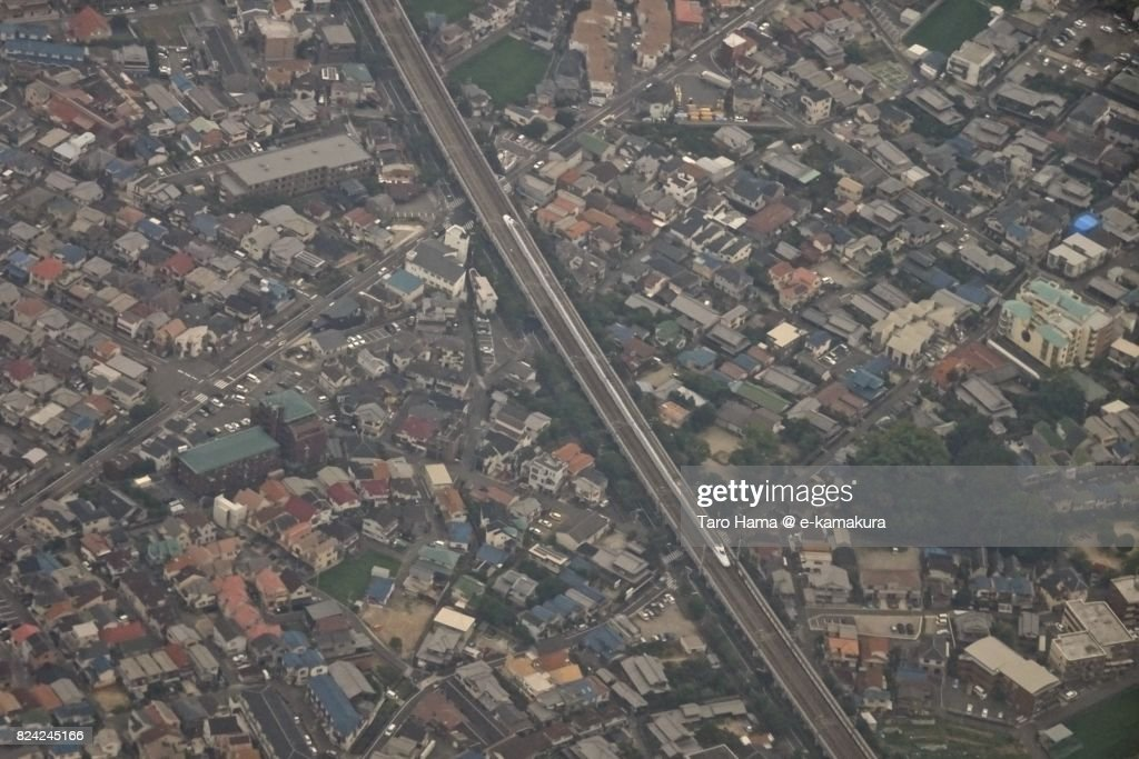 Shinkansen running in Osaka city in Osaka prefecture daytime aerial view from airplane : ストックフォト