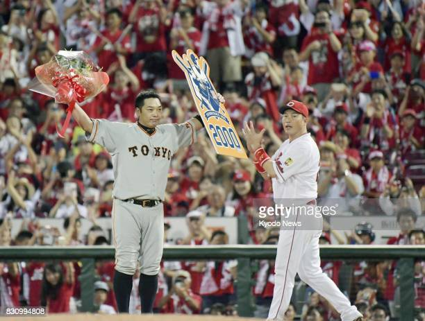 Shinnosuke Abe celebrates when he singled for his 2000th career hit in the ninth inning of the Yomiuri Giants' 41 loss to the Hiroshima Carp at Mazda...