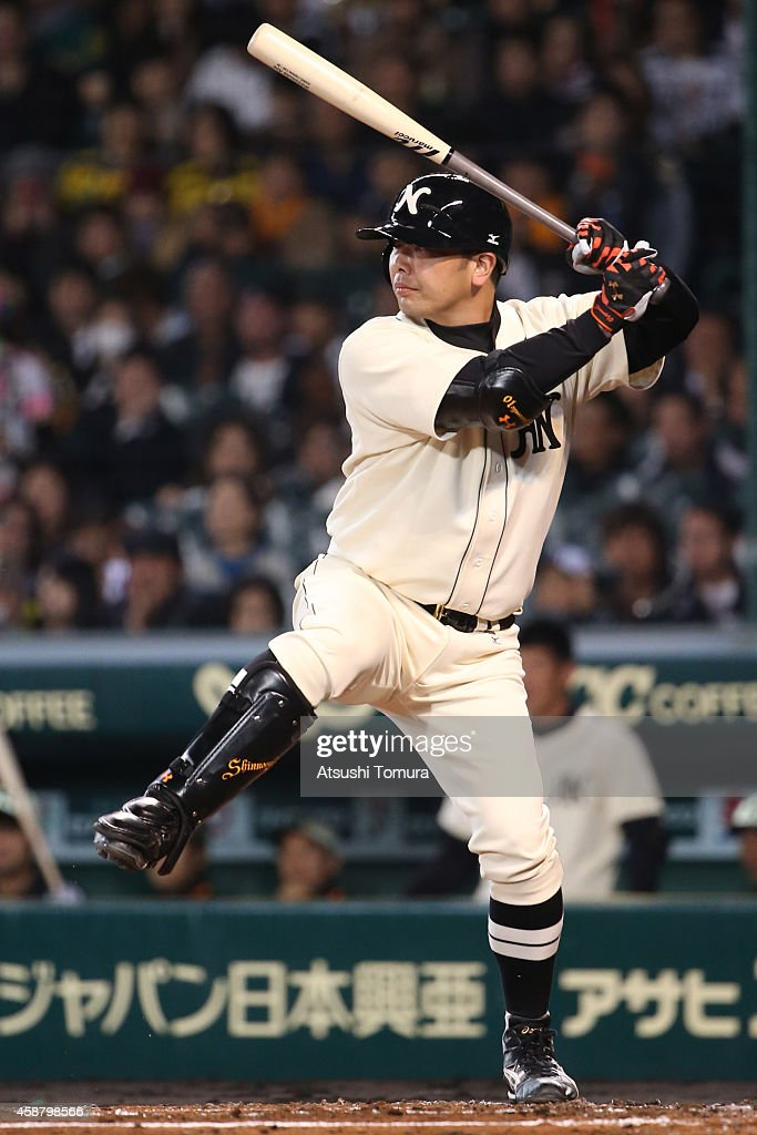 <a gi-track='captionPersonalityLinkClicked' href=/galleries/search?phrase=Shinnosuke+Abe&family=editorial&specificpeople=2708810 ng-click='$event.stopPropagation()'>Shinnosuke Abe</a> #10 of Hanshin Tigers and Yomiuri Giants in action during the friendly match between Hanshin Tigers and Yomiuri Giants at the Hanshin Koshien Stadium on November 11, 2014 in Nishinomiya, Japan.