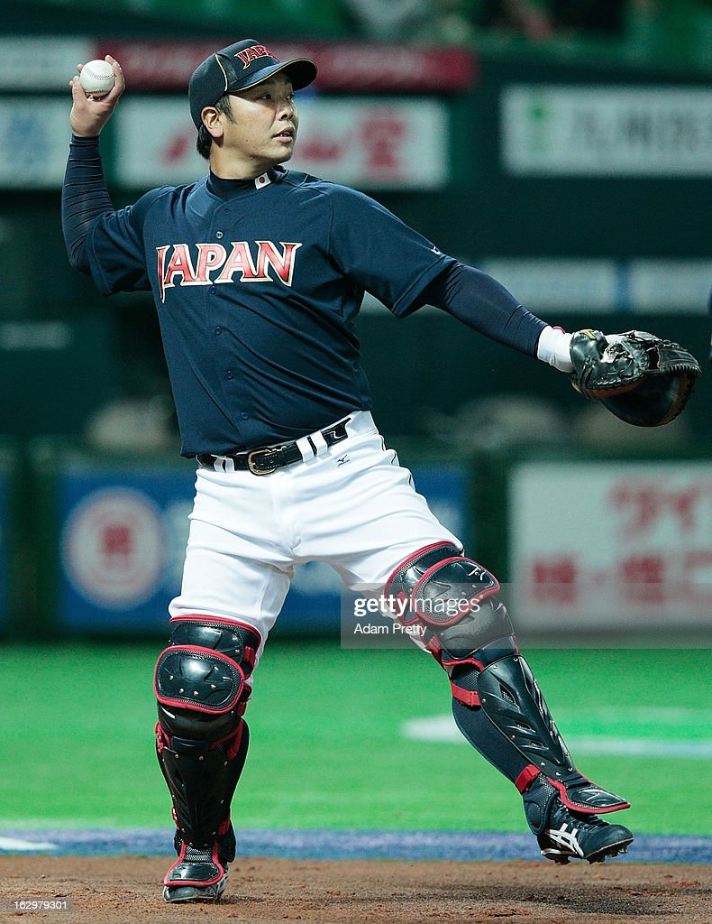 <a gi-track='captionPersonalityLinkClicked' href=/galleries/search?phrase=Shinnosuke+Abe&family=editorial&specificpeople=2708810 ng-click='$event.stopPropagation()'>Shinnosuke Abe</a> of Japan warms up before the World Baseball Classic First Round Group A game between Brazil and Japan at Fukuoka Yahoo! Japan Dome on March 2, 2013 in Fukuoka, Japan.