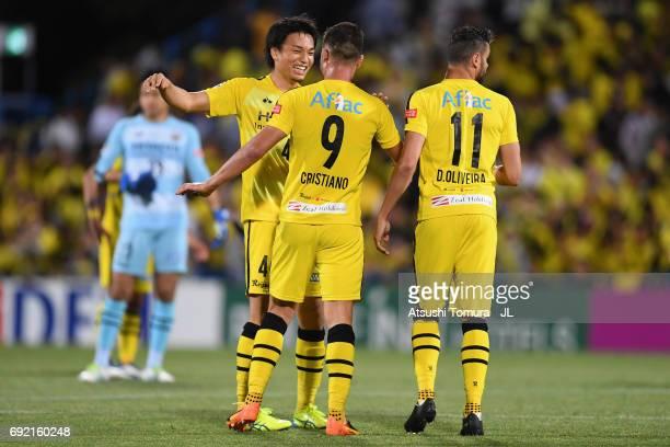 Shinnosuke Nakatani Cristiano and Diego Oliveira of Kashiwa Reysol celebrate their 10 victory after the JLeague J1 match between Kashiwa Reysol and...
