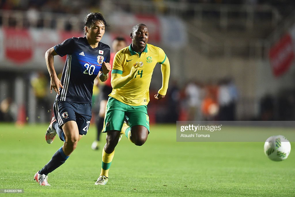 Shinnosuke Nakatani of Japan and Gift Motupa of South Africa compete for the ball during the U-23 international friendly match between Japan and South Africa at the Matsumotodaira Football Stadium on June 29, 2016 in Matsumoto, Nagano, Japan.