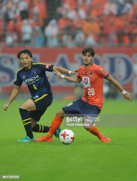 Shinnosuke Nakatani of Kashiwa Reysol and Ariajasuru Hasegawa of Omiya Ardija compete for the ball during the JLeague J1 match between Omiya Ardija...