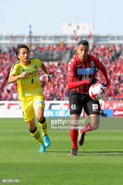 Shinnosuke Nakatani of Kashiwa Reysol and Jay Bothroyd of Consadole Sapporo compete for the ball during the JLeague J1 match between Consadole...